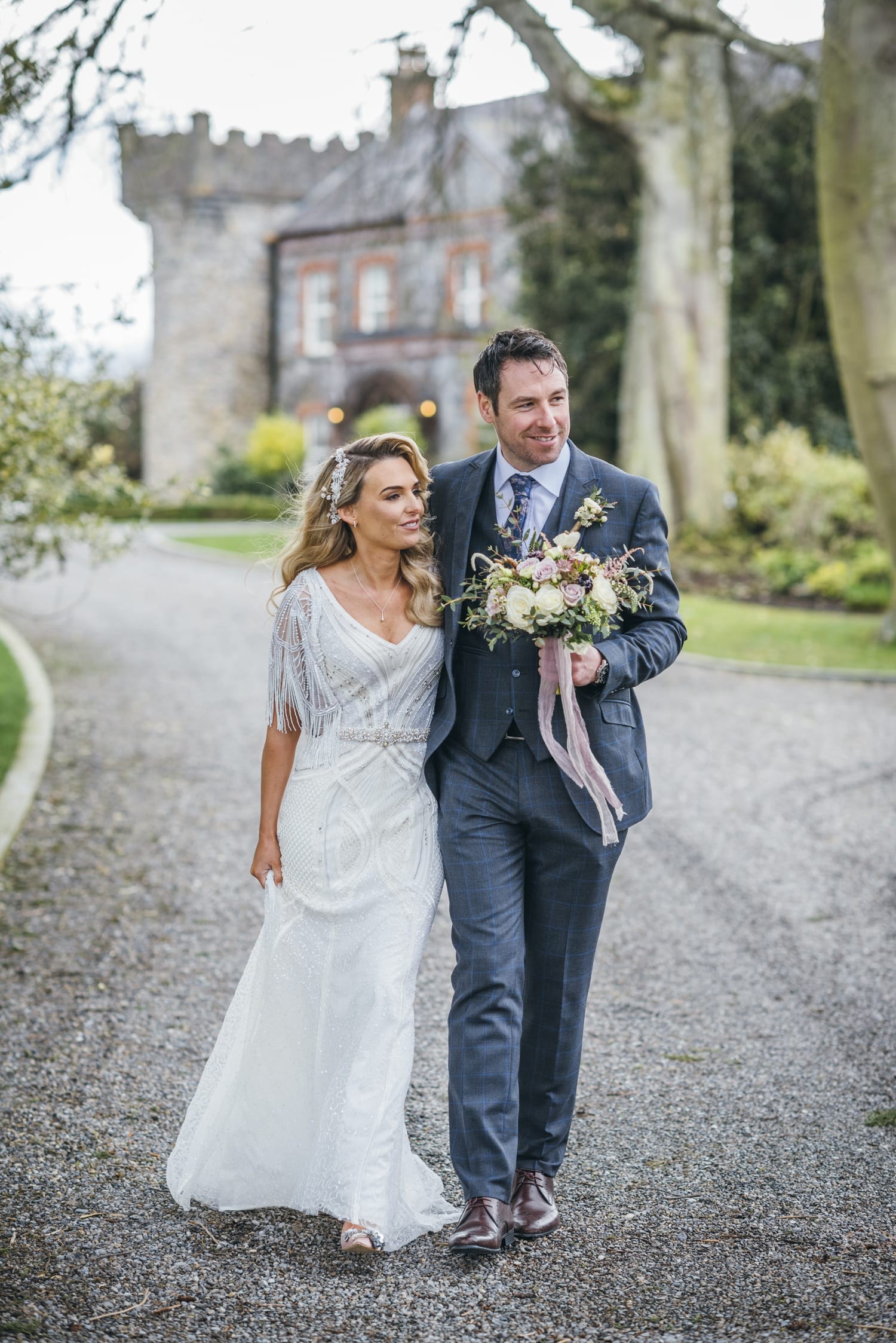 Couple walking at Ballymagarvey Village wedding