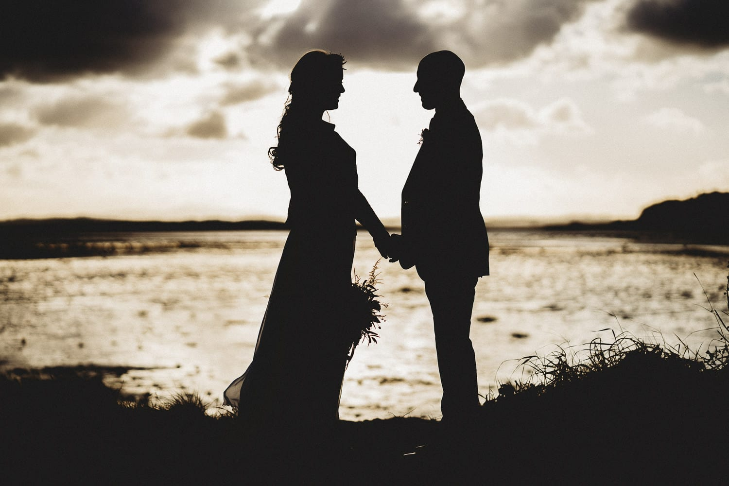 Silhouette of bride and groom at orange tree House