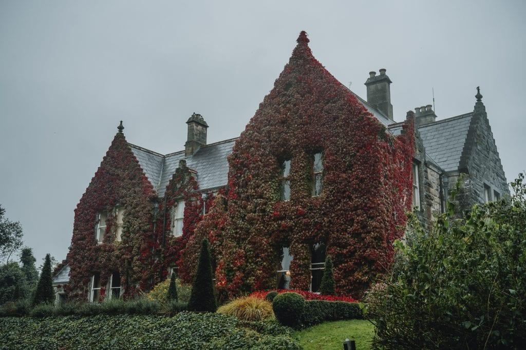 Castle Leslie building covered in red ivy