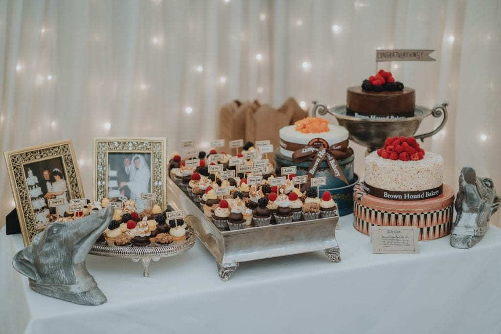Wedding cakes sitting on a table at a Castle Leslie wedding