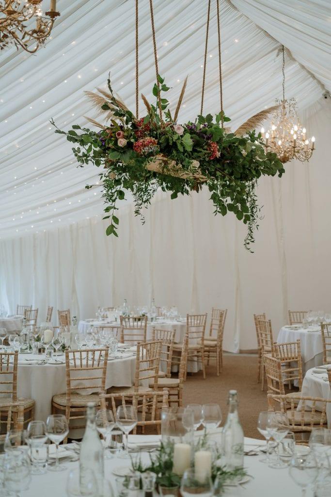 Reception room at Castle Leslie with hanging flower displays