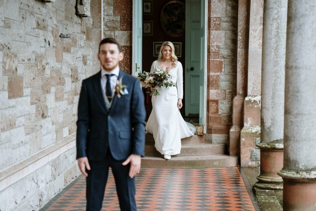 bride and groom first look outside Castle Leslie