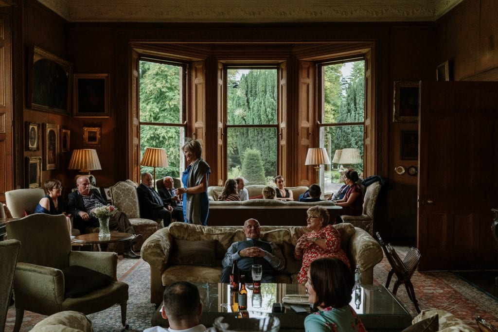 Guests relaxing indoors at Castle Leslie wedding