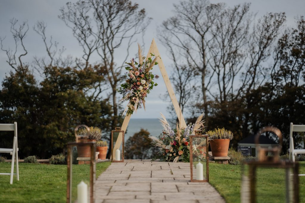 triangle wooden decorative wedding arch with flowers